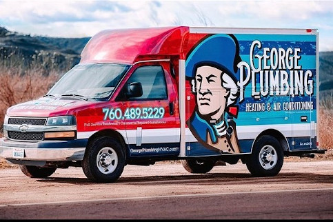 george plumbing heating and air work truck parked on the side of the road.