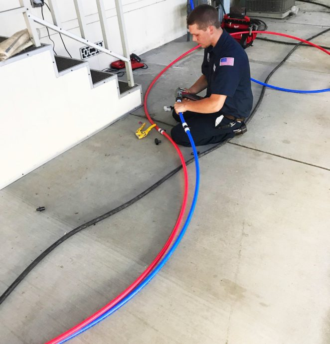 george plumbing heating and air employee working. Shane